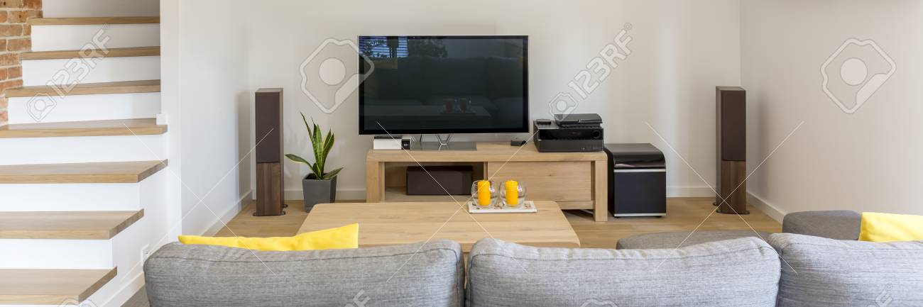 Stairs In Cozy Wooden Living Room With Sofa And Home Cinema Stock Photo    82088482