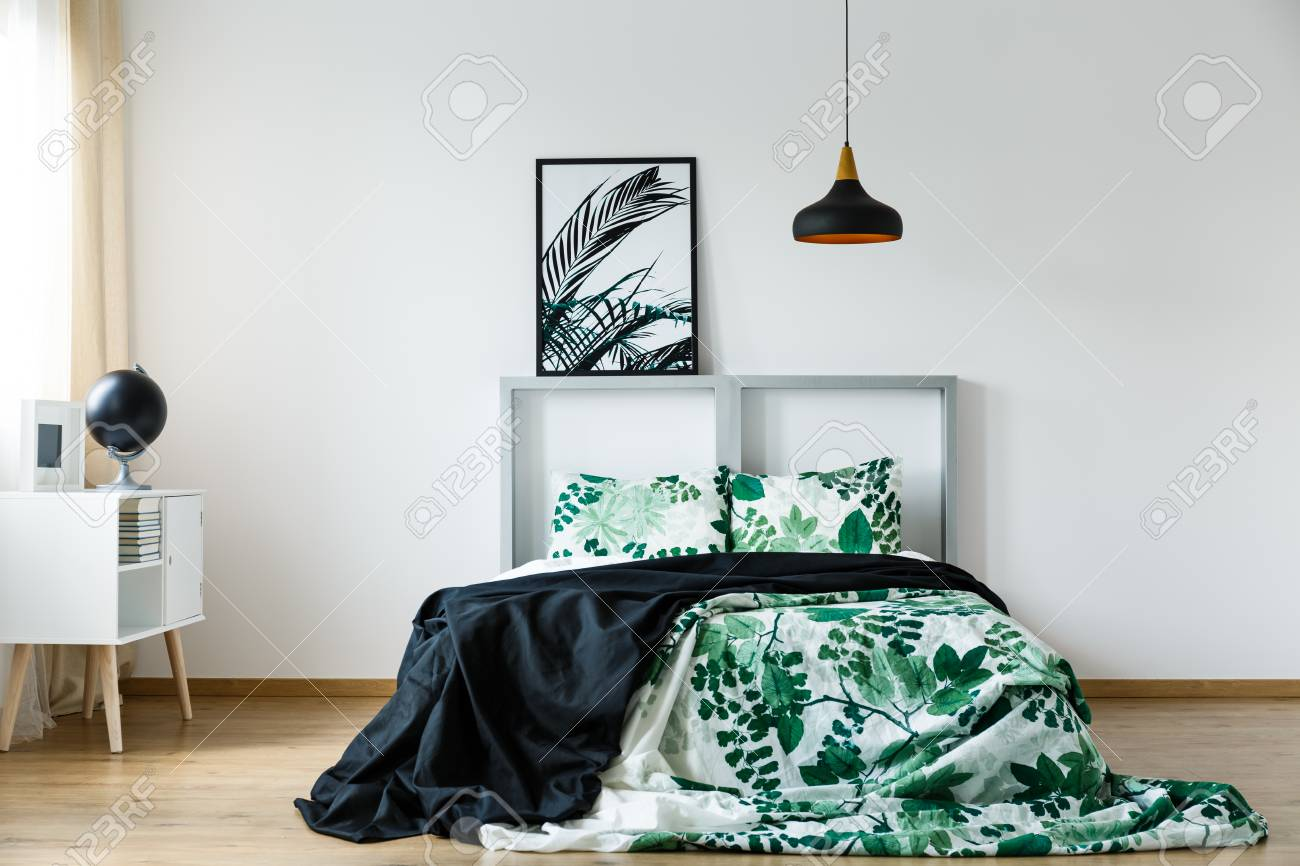 Black Blanket On Floral Green And White Bedding On Bed Stock Photo Picture And Royalty Free Image Image 82663606