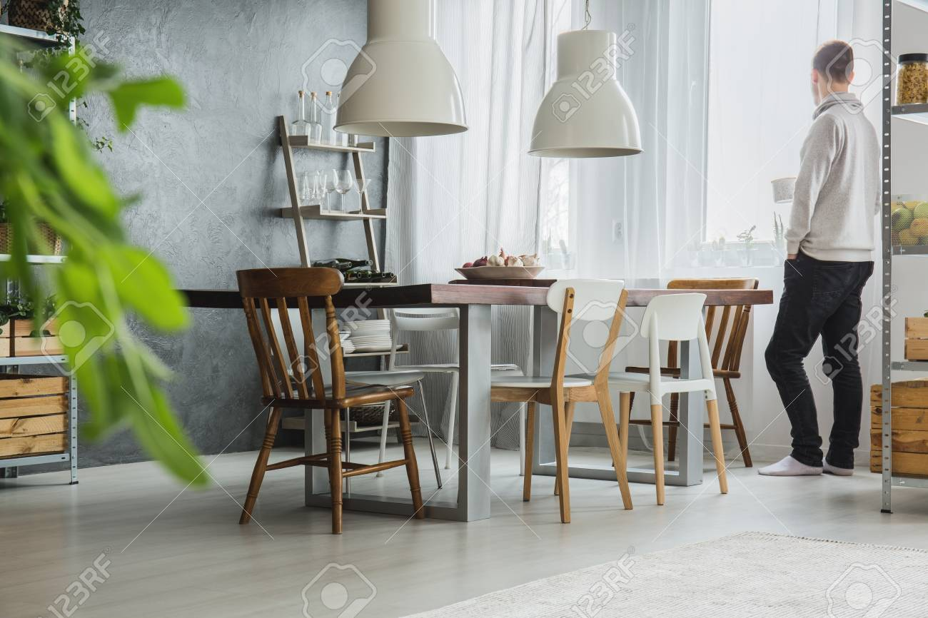Modern, industrial dining room with concrete wall