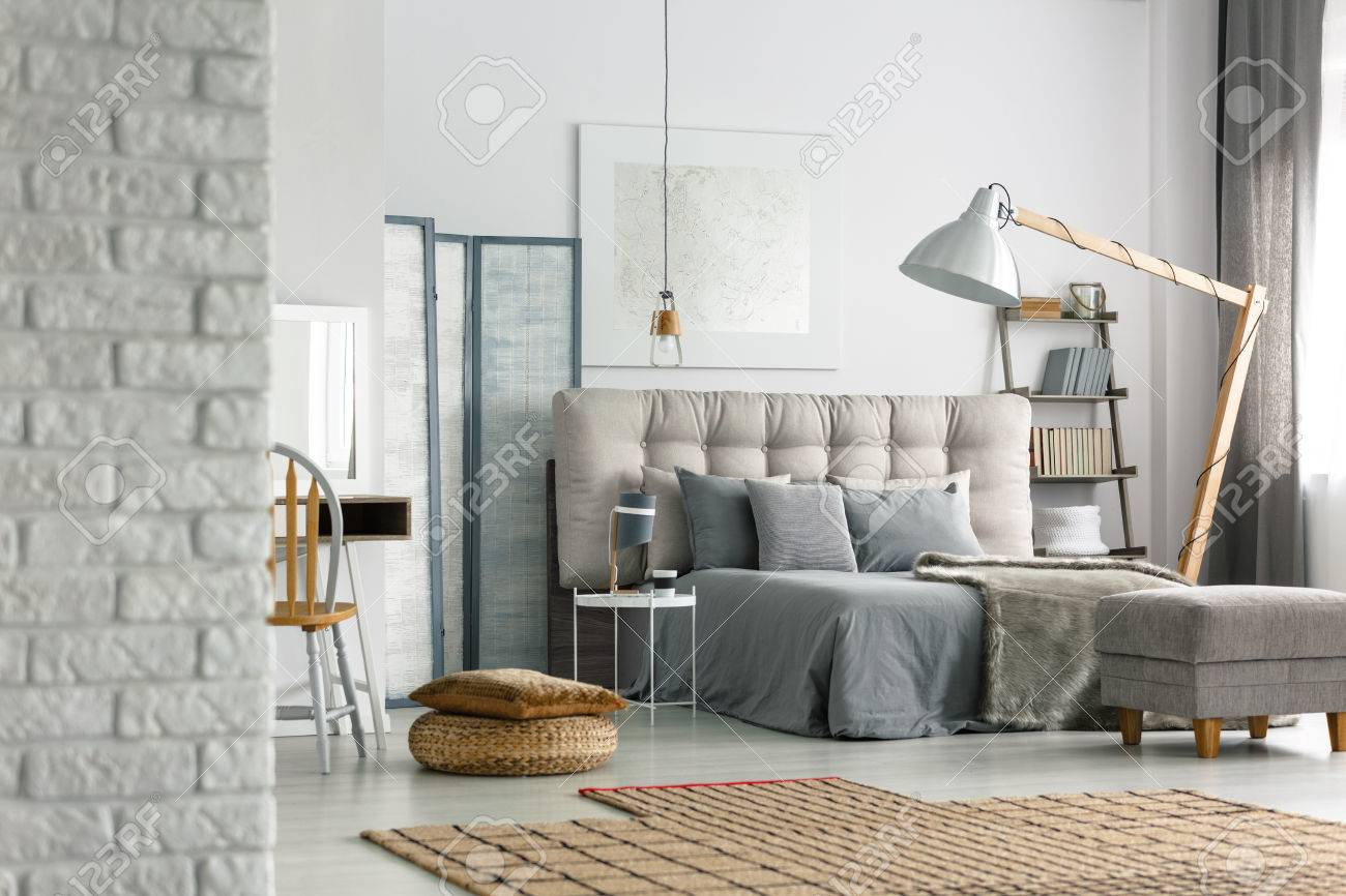 Cozy Grey Bedroom In Modern Loft With White Brick Wall Stock Photo Picture And Royalty Free Image Image 81889353