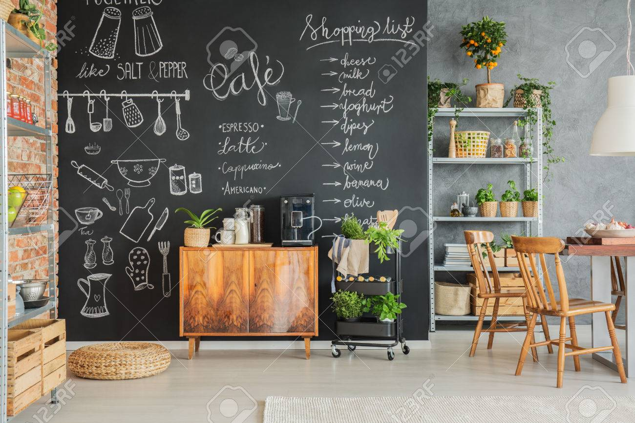 Chalkboard Wall With Cute Drawings In The Family Kitchen