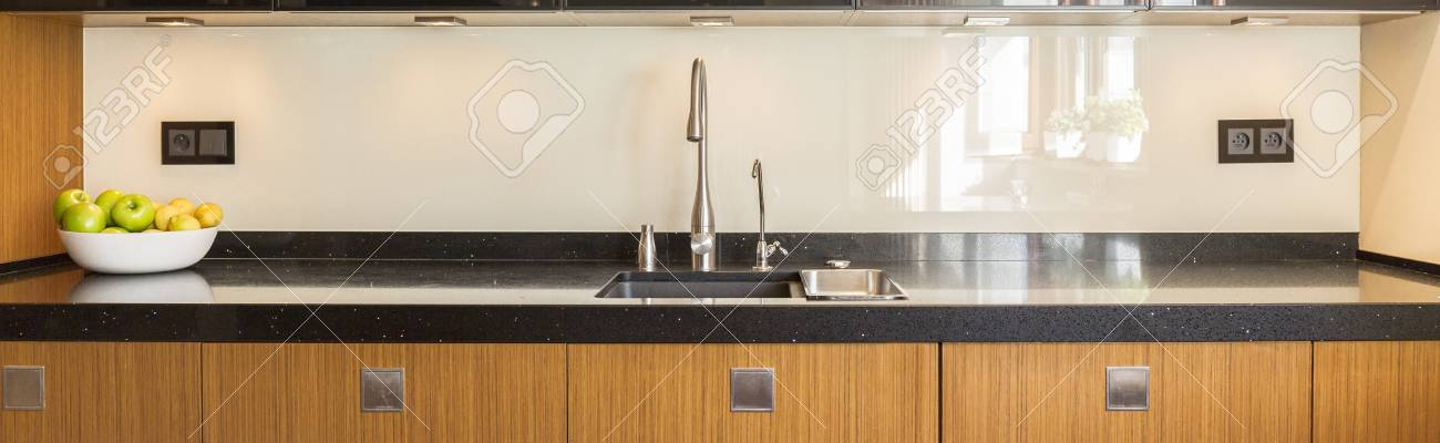 Kitchen Interior With Wooden Furniture And Marble Worktop Stock