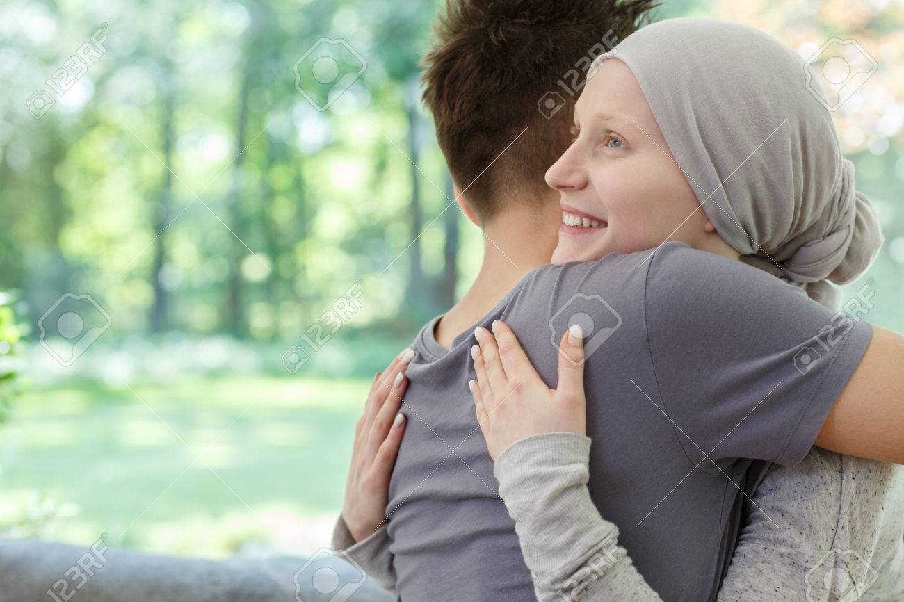 Young happy couple hugging after hearing the good news - 82091285