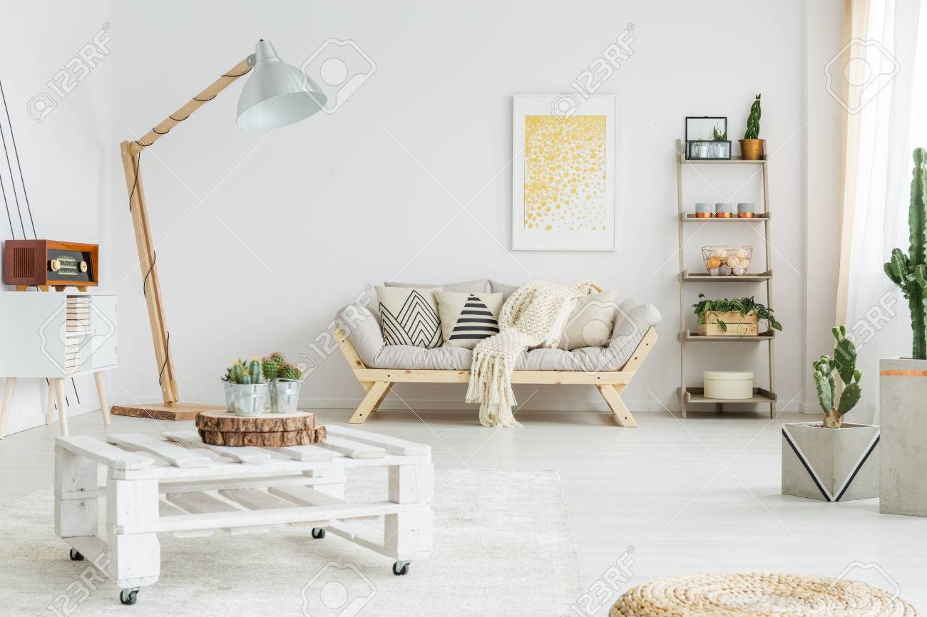 White Hand-made Pallet Table With Plants In Living Room Stock Photo ...