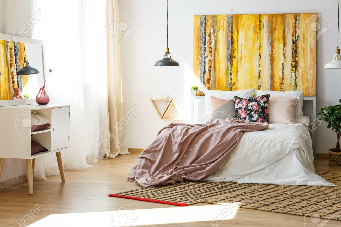 Nice and stylish bedroom in warm colors - 82253695