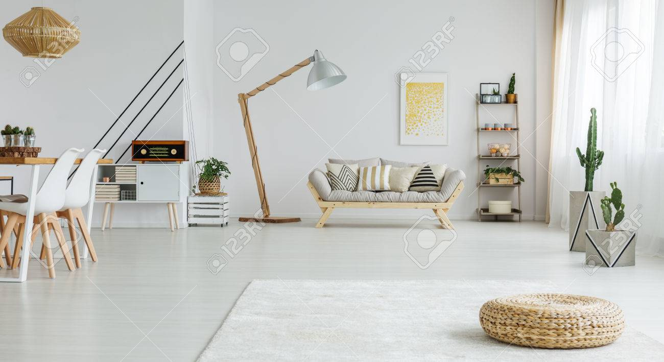 Cozy White Living Room With Dining Space And Wooden Sofa Stock Photo Picture And Royalty Free Image Image 82267782