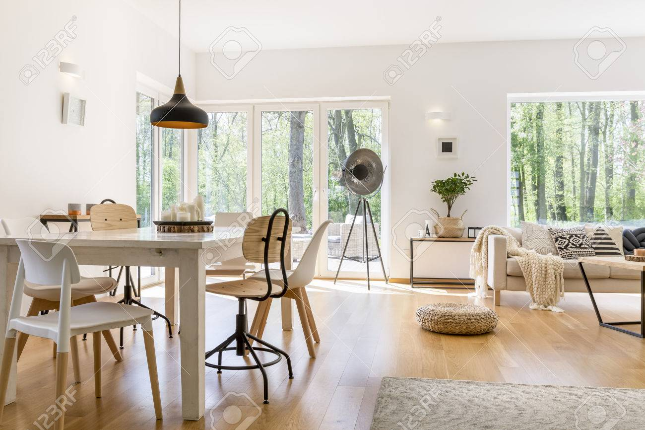 Dining Space With Wooden Table In Cozy Modern Lounge Stock Photo   82322583