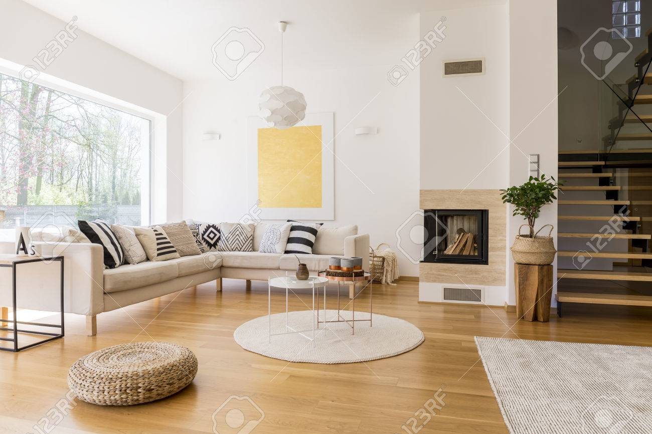 stock photo stylish white living room with wooden stairs to the first floor - Wooden Stairs