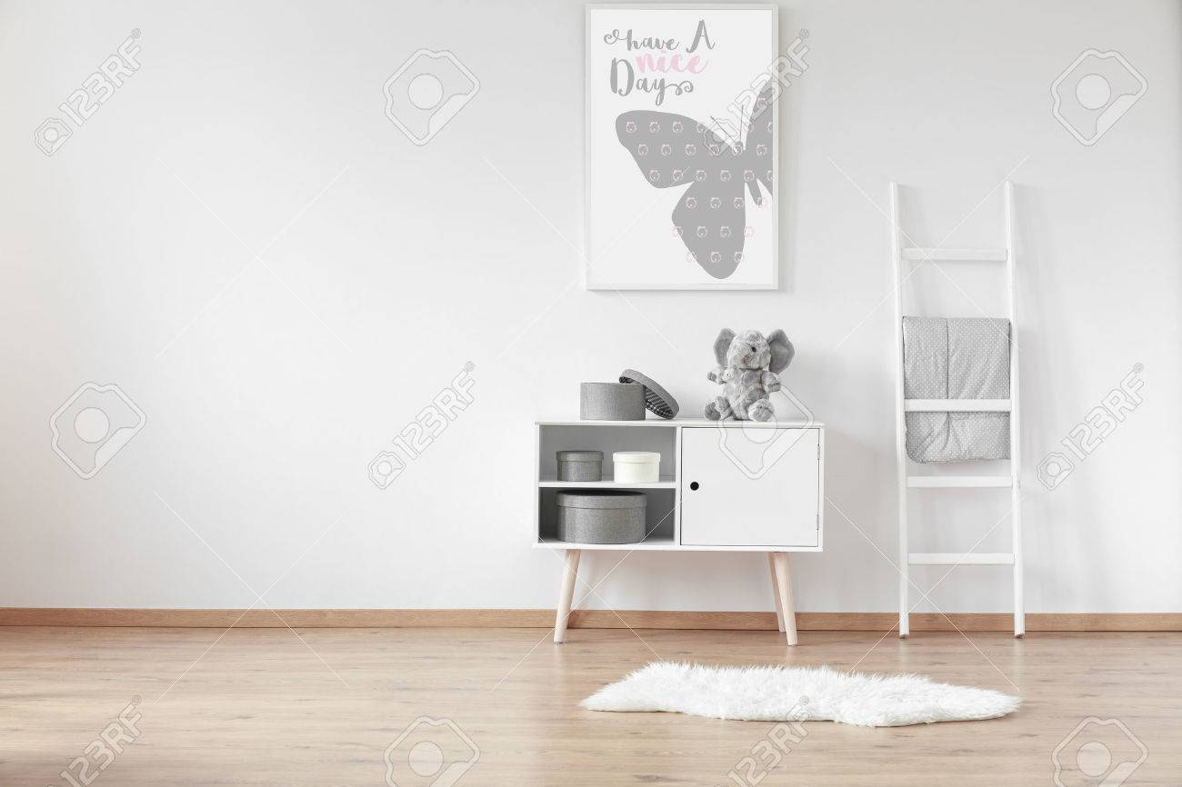 White Wooden Cupboard With Round Cardboard Boxes And Fluffy Rug ...