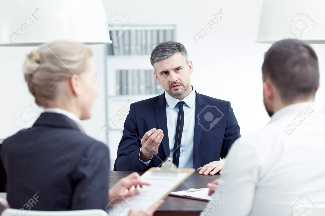 man applying for promotion during interview with board members stock photo 82489945