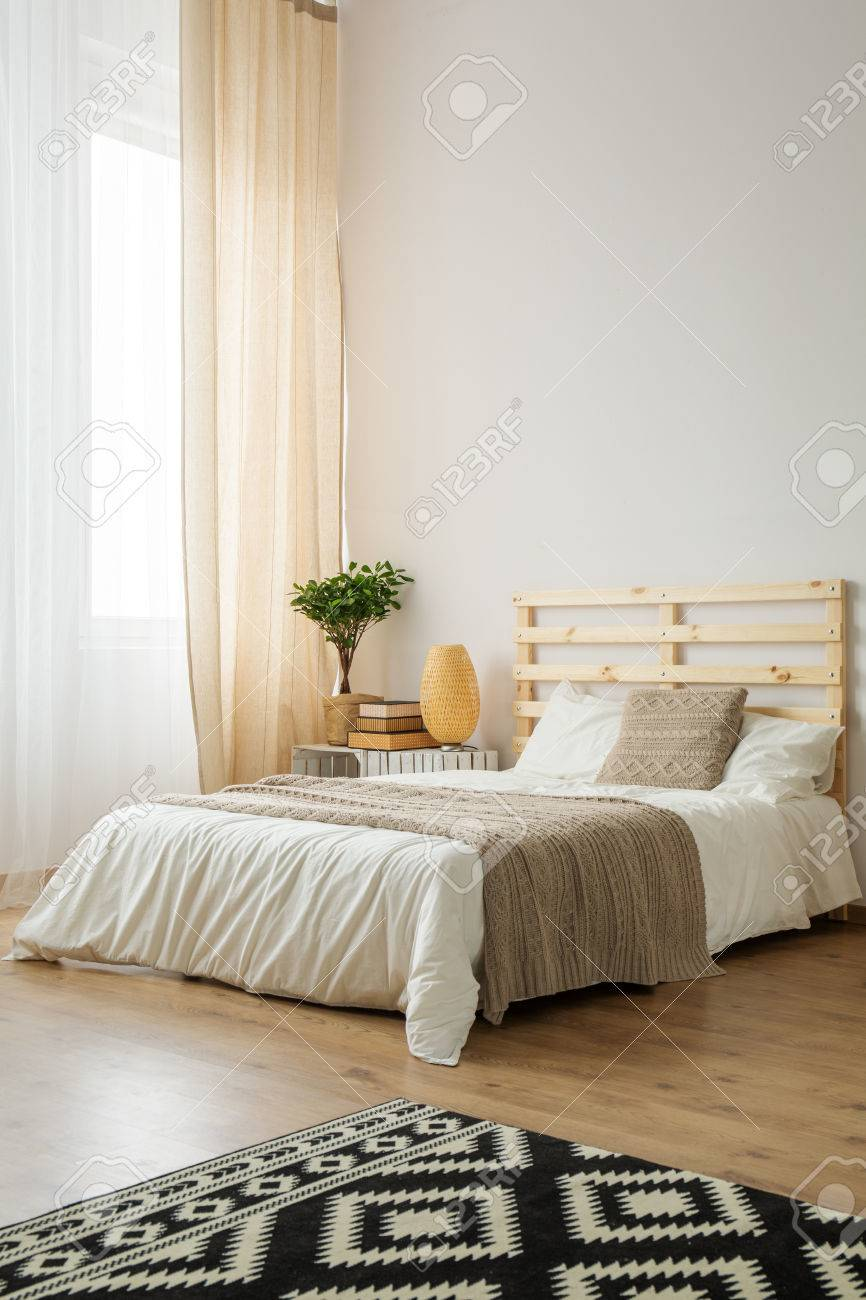 Beige and white minimalist bedroom for young hipster