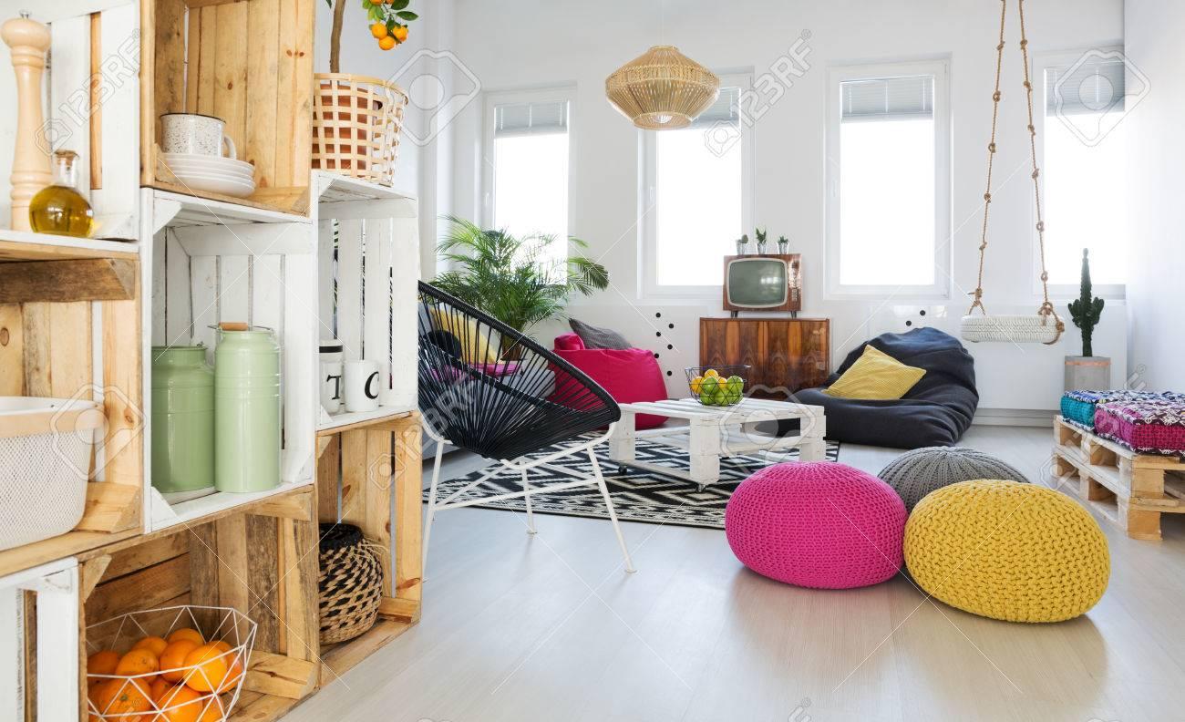 123RF.com & Inspiring trendy living room with DIY crate shelf and swing