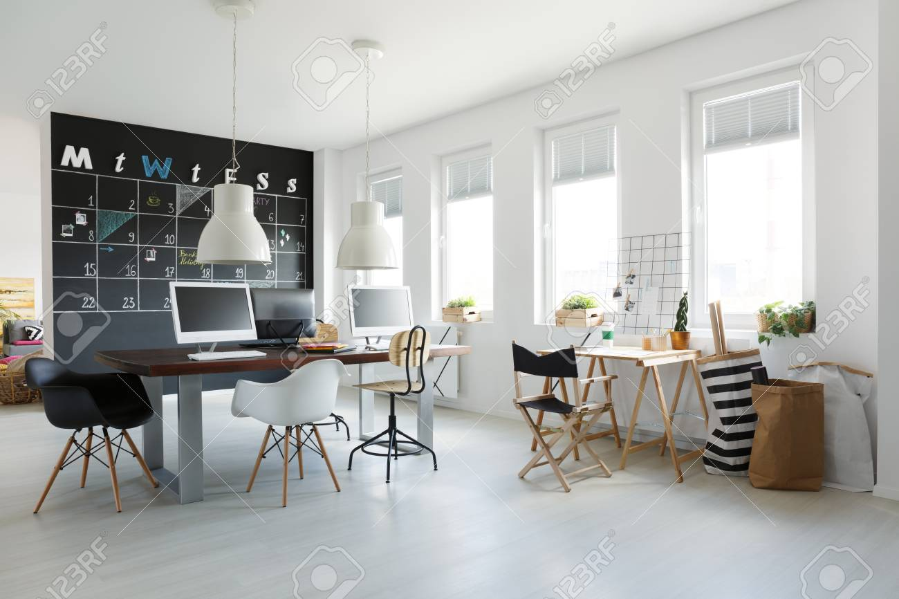 trendy office. Stock Photo - White Open Space Trendy Office With Blackboard Calendar On Wall