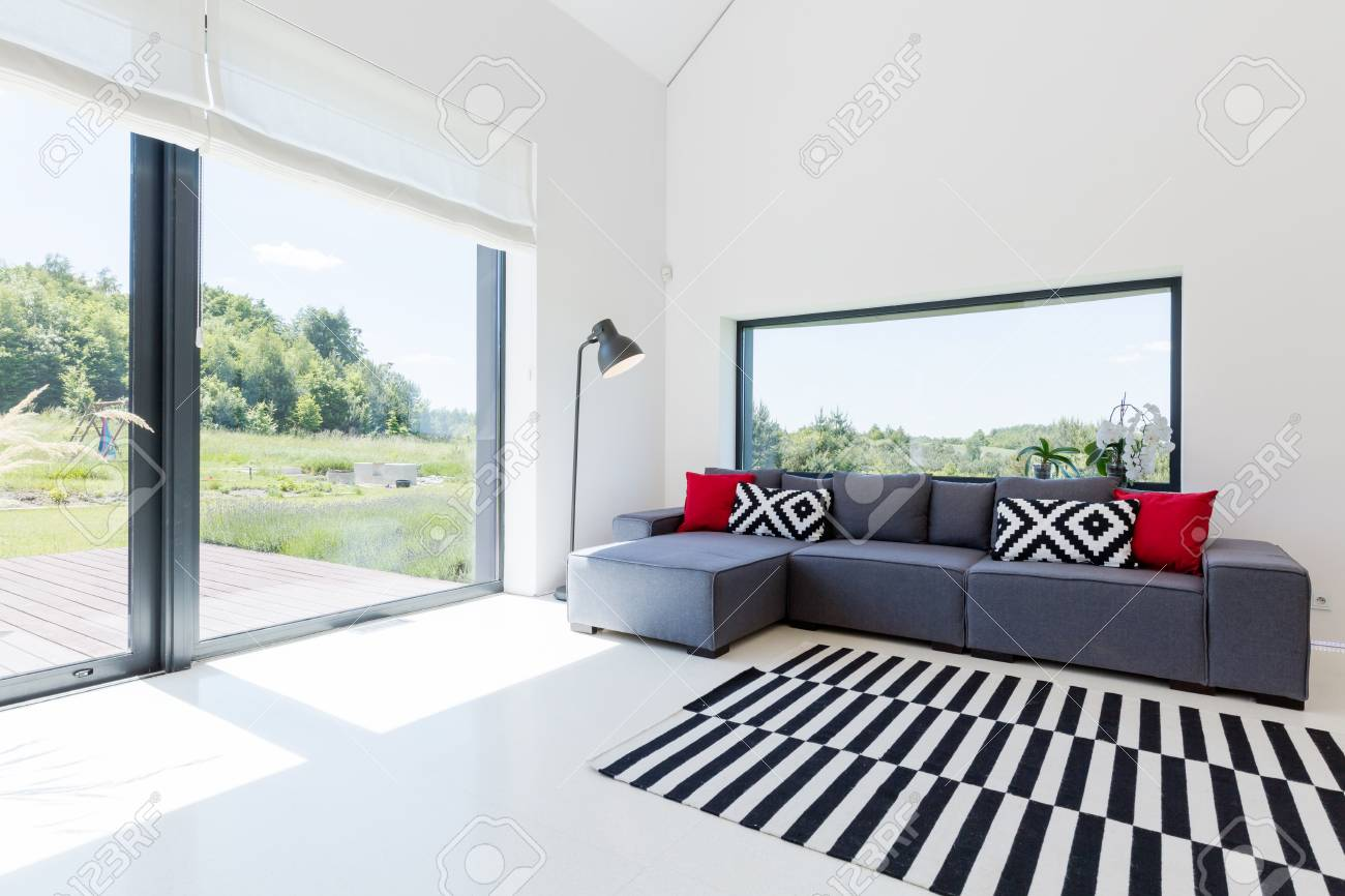 Very bright living room in a modern house, with a large corner..
