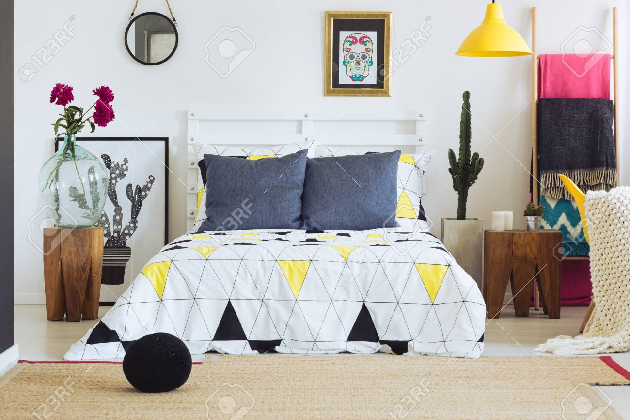Contemporary bedroom decor with mexican accents and geometric..
