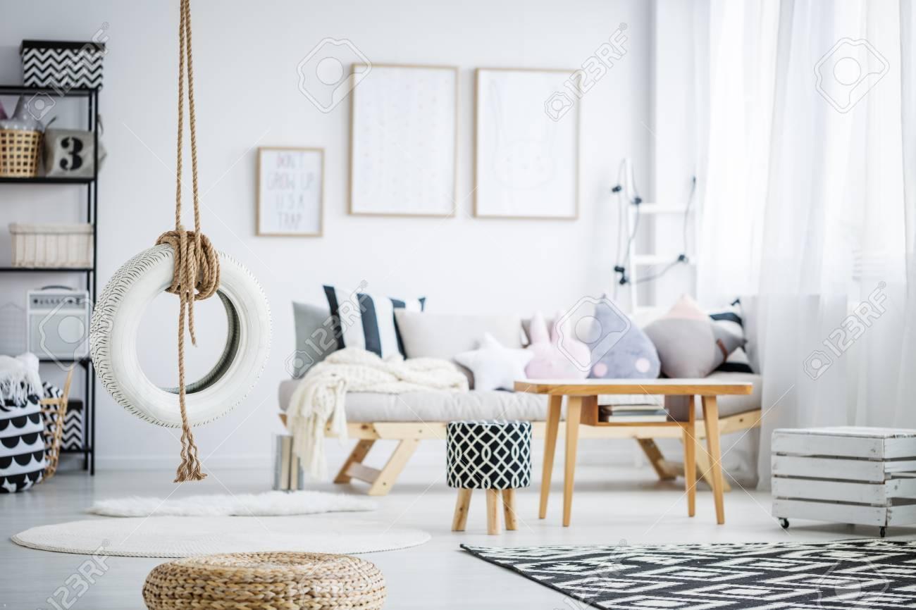 Simple DIY Tire Swing In Trendy Pastel Scandinavian Room Stock Photo ...