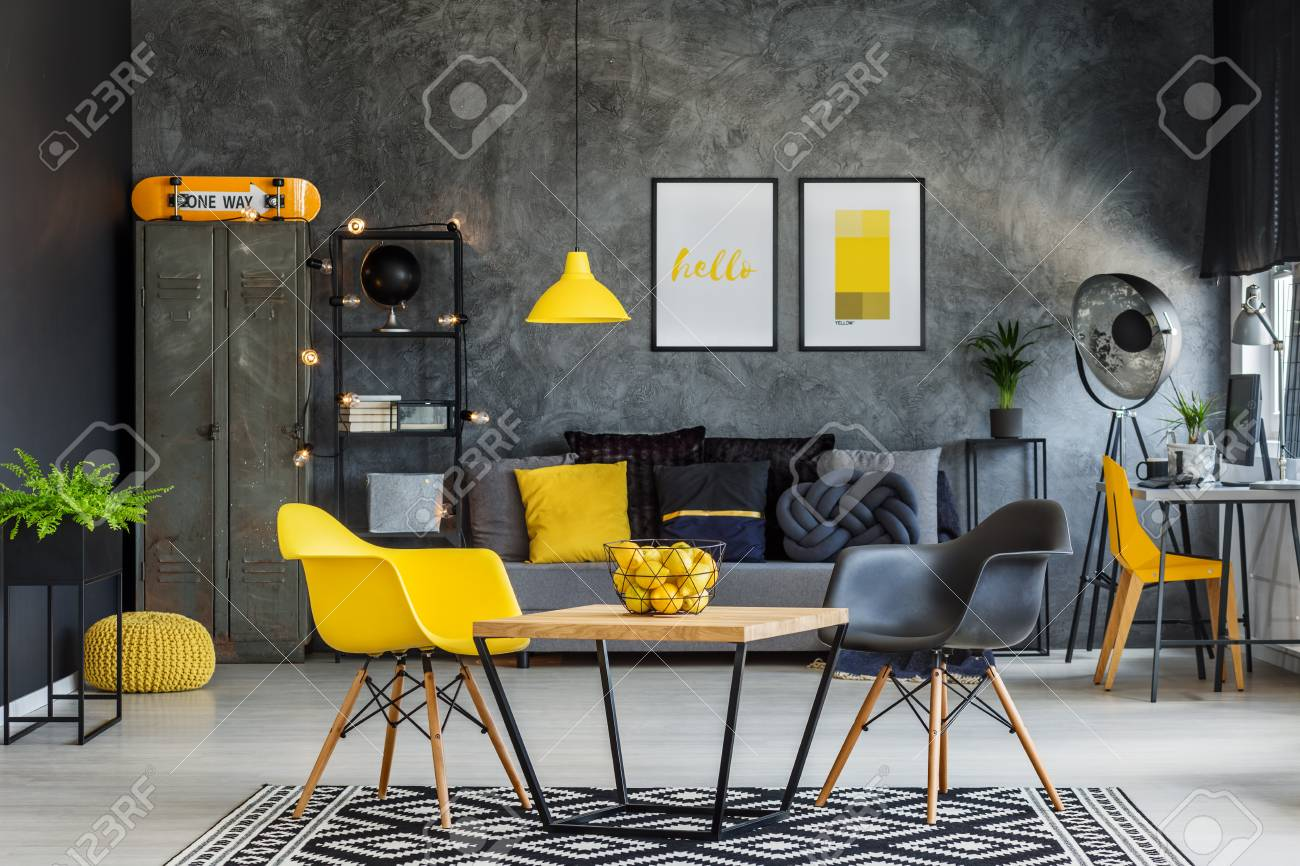 Modern Furniture In Unique Yellow And Gray Industrial Office.. Stock ...