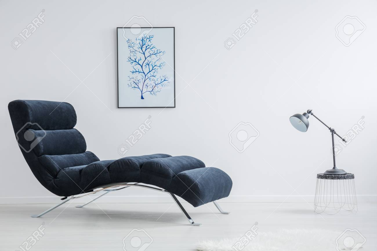 Designed Small Table With Black Lamp Stands Against Modern Chaise Stock Photo Picture And Royalty Free Image Image 83573616