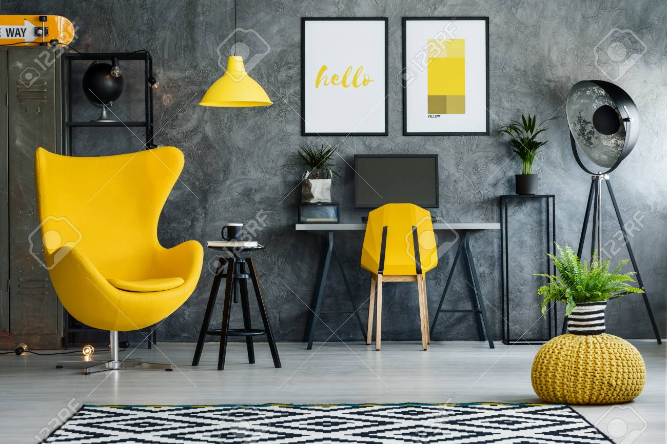 photo workspace for teenager with desk armchair yellow details and posters