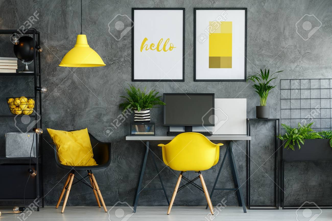 Office area in contemporary interior with yellow decor and modern furniture stock photo 83344325