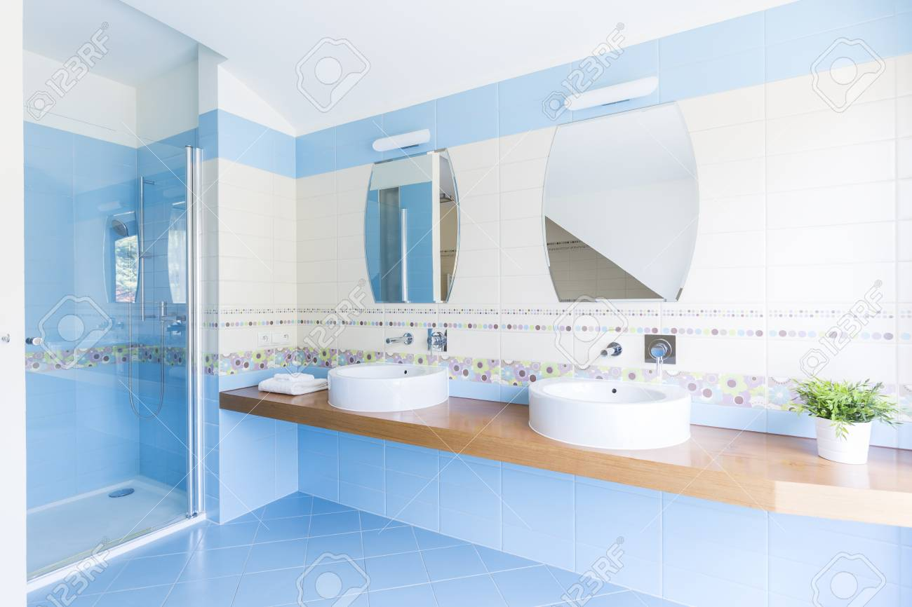 Big Modern Bathroom With Blue And White Tiles And Two Sinks... Stock ...
