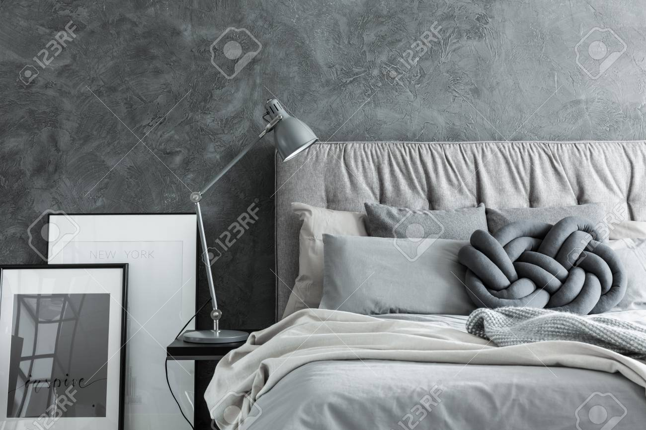 Close Up Side View Of Cozy Modern Bedroom With Gray Headboard Stock Photo