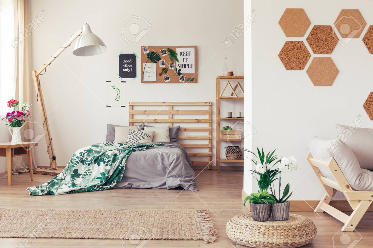 Wooden Bed And Couch In Botanic Open Interior With Cork Honeycomb ...