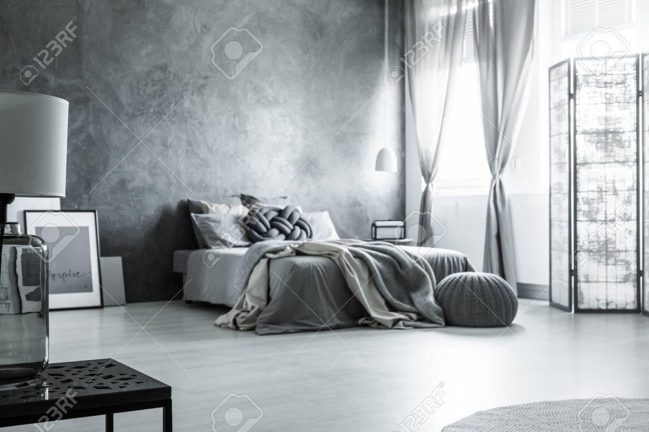Scandinavian Minimalist Design In Monochromatic Gray Bedroom Stock - Gray-bedroom-minimalist