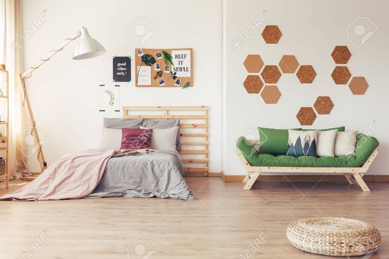 Green accents in simple scandinavian interior with wooden furniture,..