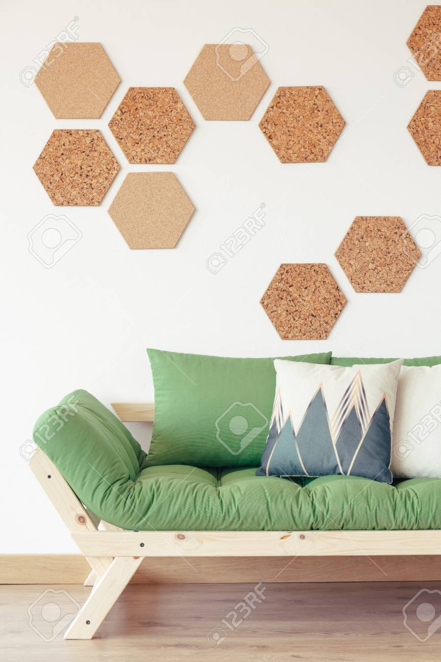 Natural Wood Green Couch And Cork Hexagon Board Tiles In Modern