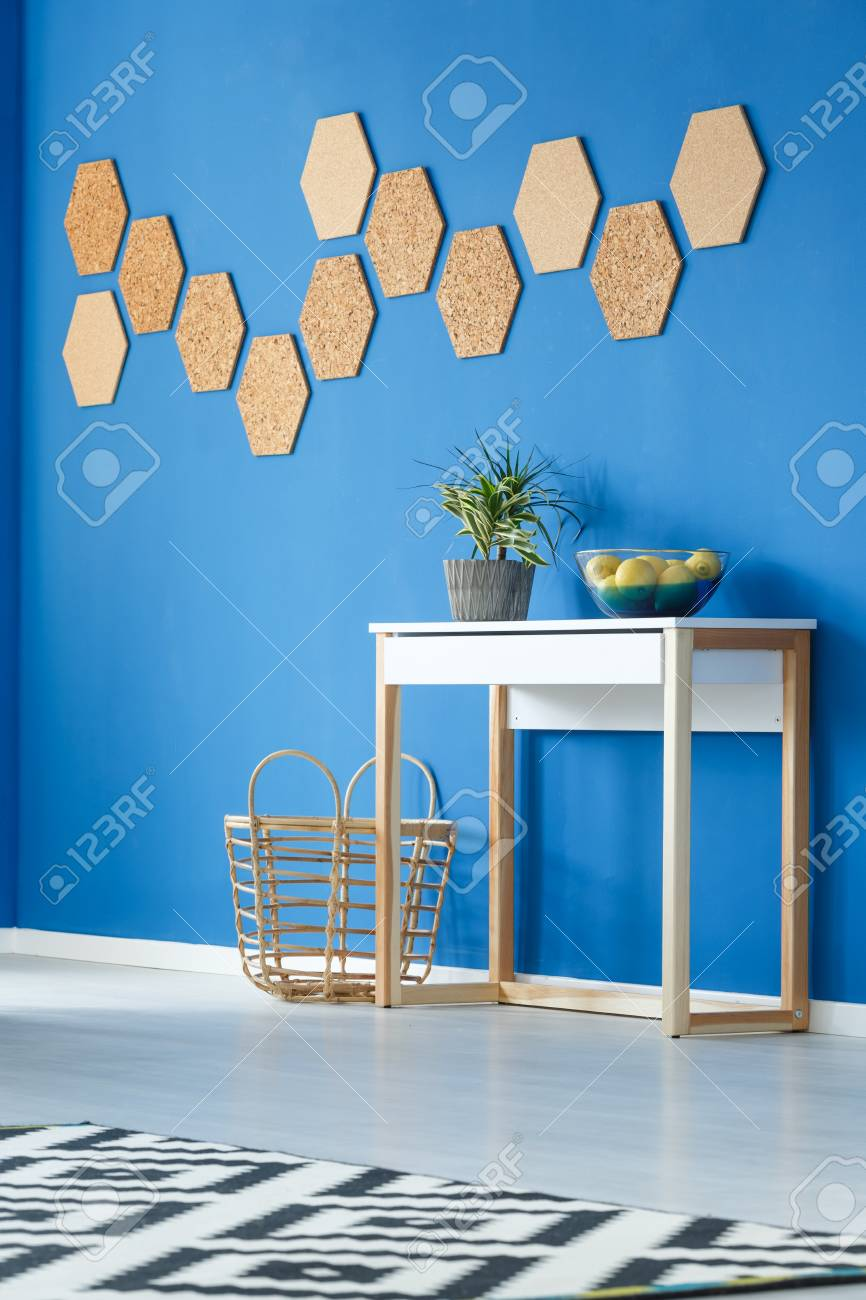 stock photo trendy royal blue living room interior design with simple cupboard potted plant cork decoration and basket