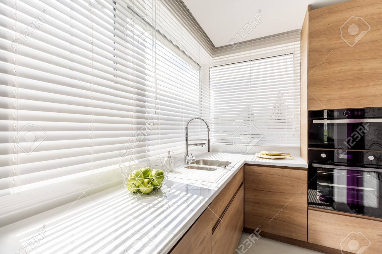 Modern Bright Kitchen Interior With White Horizontal Window Blinds Stock Photo Picture And Royalty Free Image Image 84333551