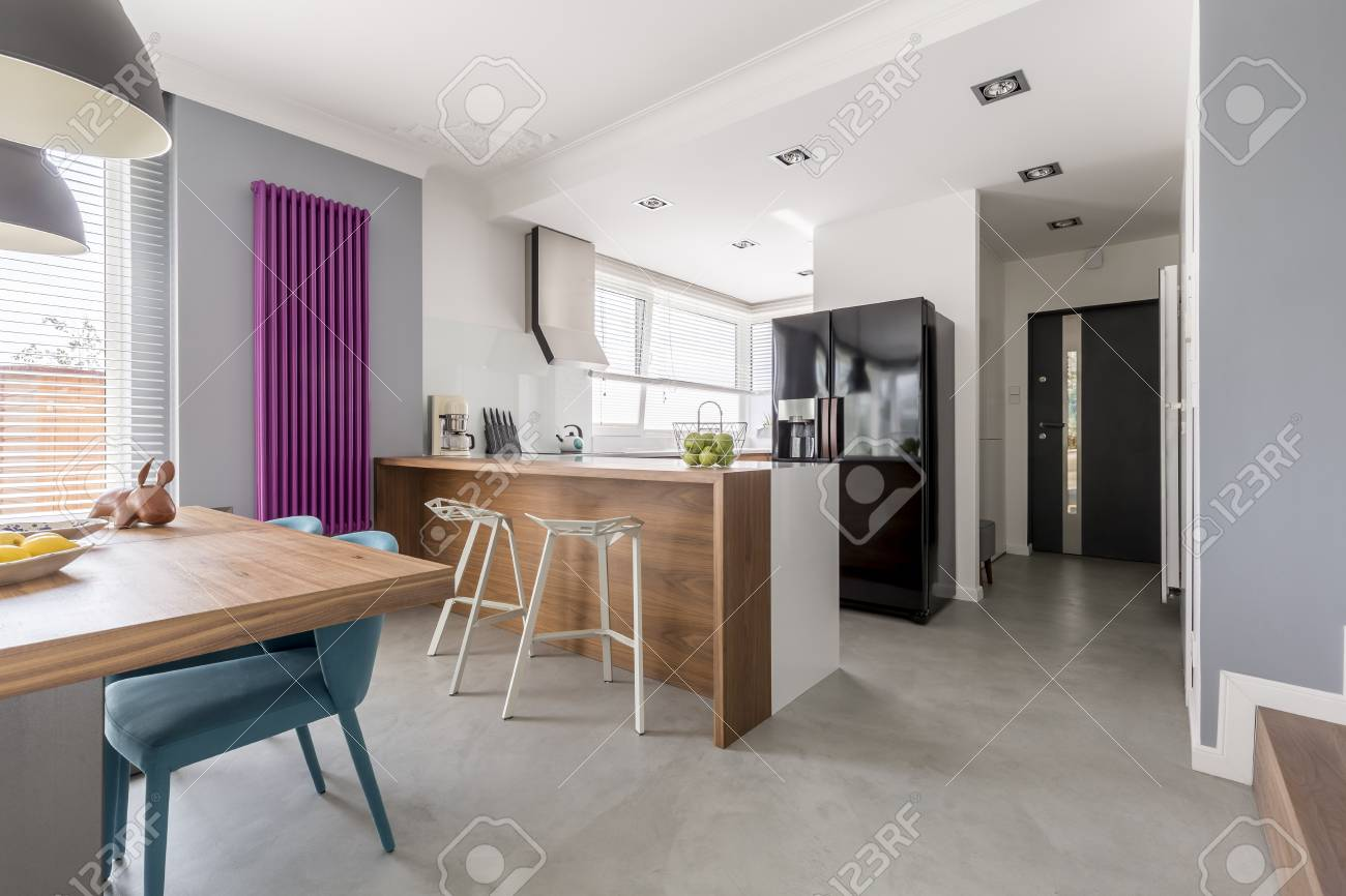 Dining room, kitchen and entrance in contemporary family house..