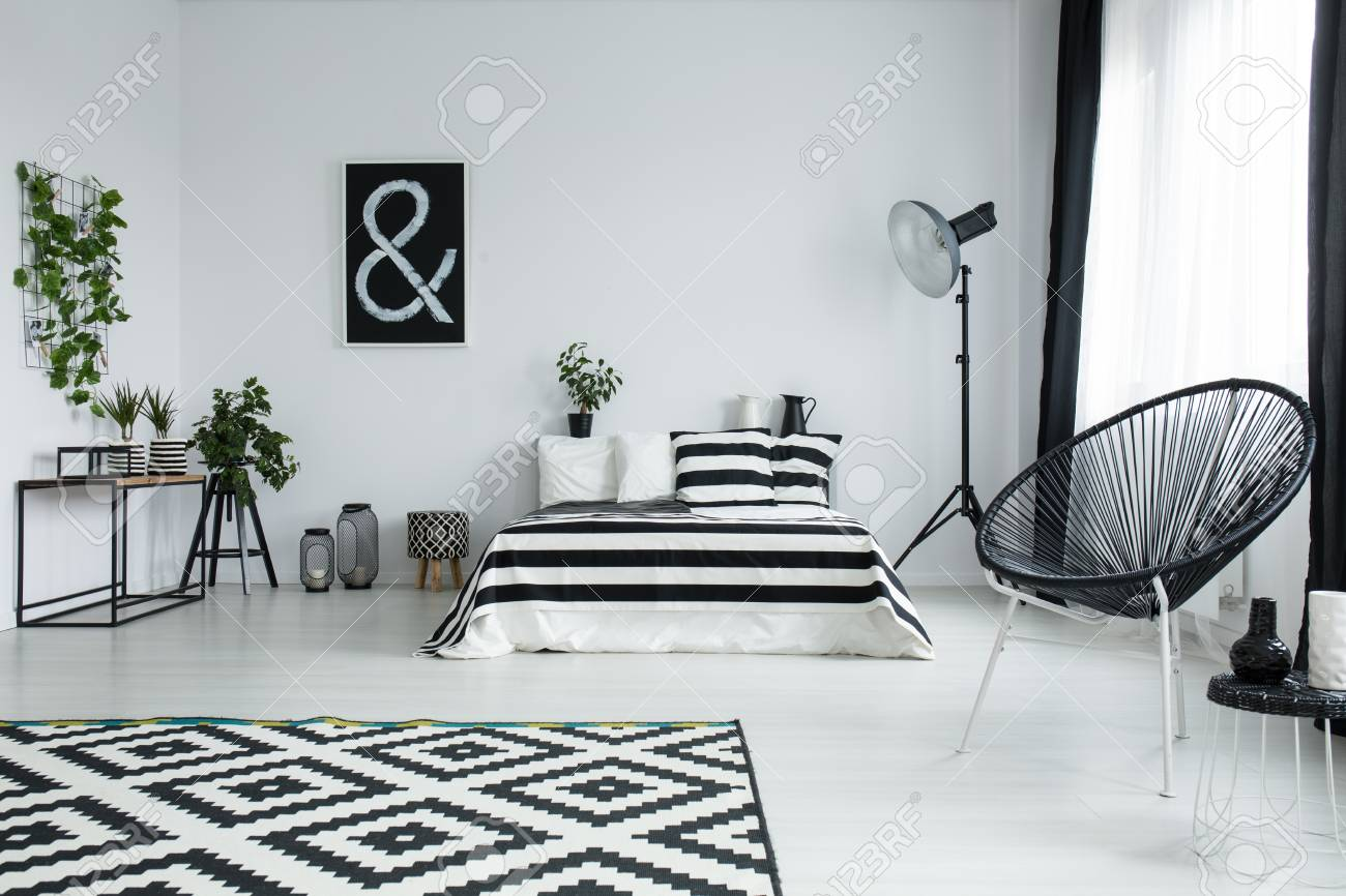 Patterned Black And White Carpet On Glossy Floor In Stylish Bedroom Stock Photo Picture And Royalty Free Image Image 83779638