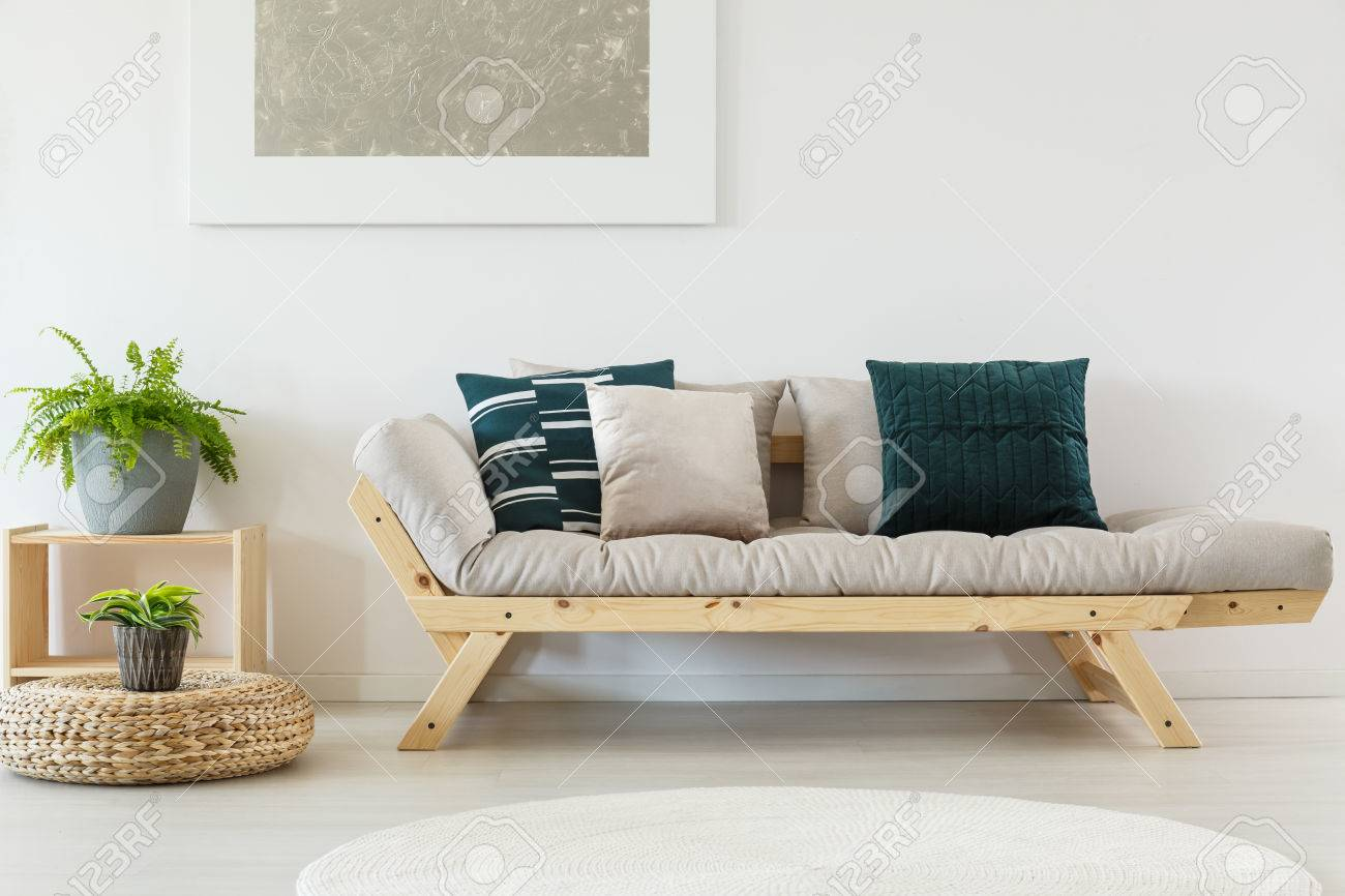 Picture of: Trendy Beige Sofa With Navy Blue Pillows And Wooden Frame Cupboard Stock Photo Picture And Royalty Free Image Image 83779640