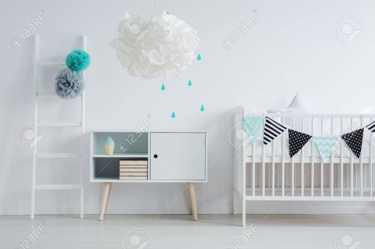 Modern lamp in children\'s bedroom along with a small ladder,..