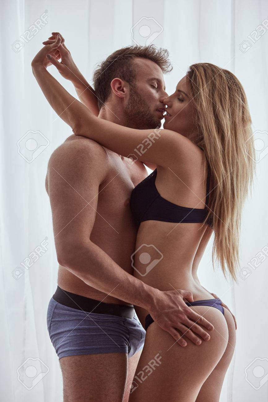 Handsome Man In Boxers Touching His Sexy Wifes Bottom Stock Photo