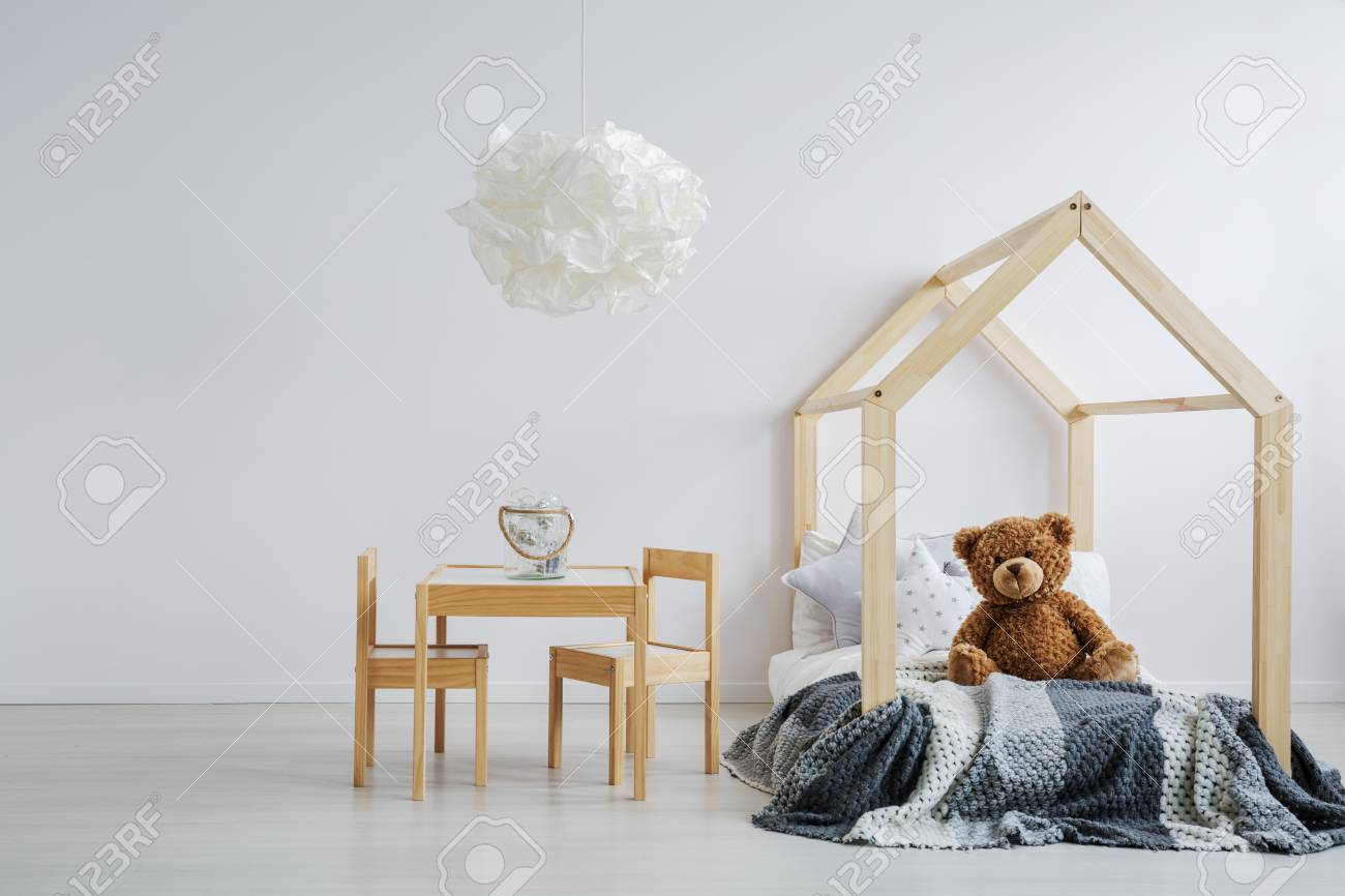 Modern Kid S Room With A Teddy Bear Sitting On A Stylish Wooden