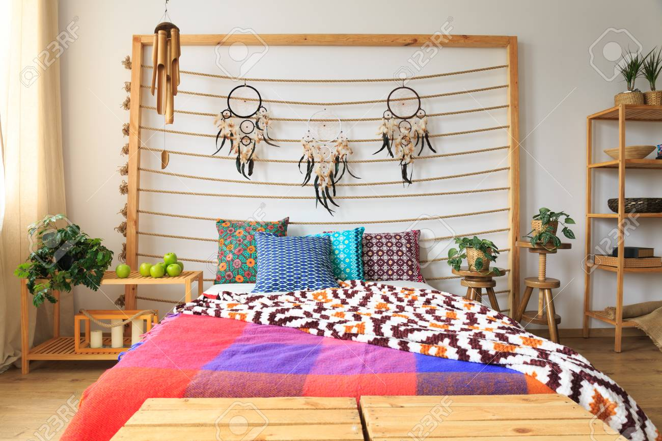 Ethnic Ethereal Bedroom With Colorful Bed Sheets Stock Photo   84495597