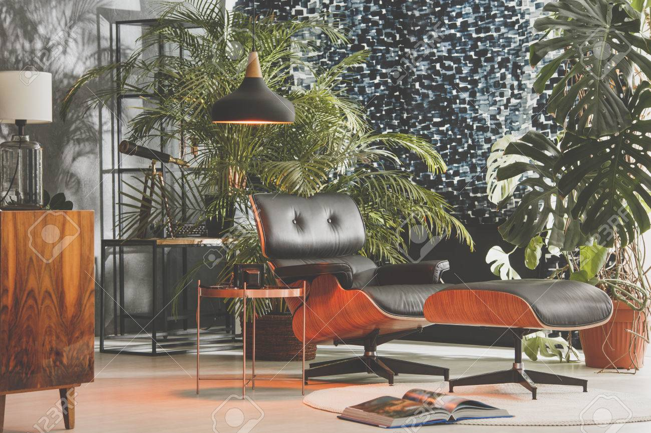 Retro style living room with a lot of exotic plants