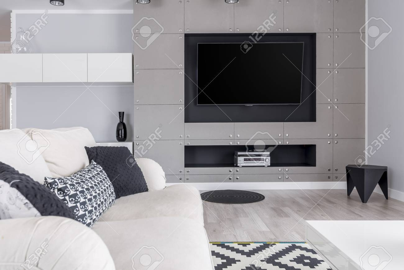 Modern Trendy Gray Living Room With Tv On Wall And Elegant Sofa Stock Photo Picture And Royalty Free Image Image 84519780