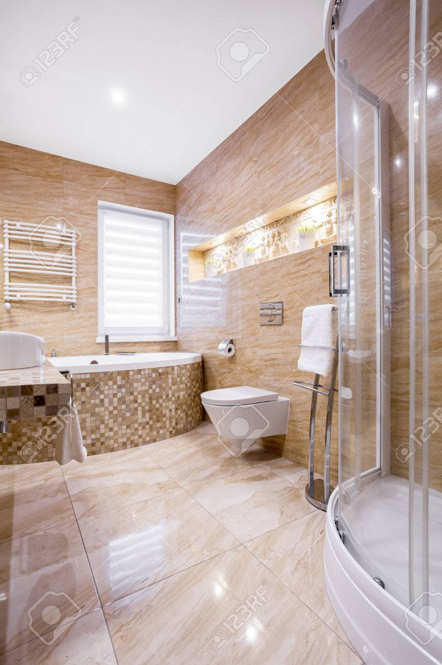 Superbe Sandstone Fancy Bathroom With Bath And Shower Stock Photo   84519775