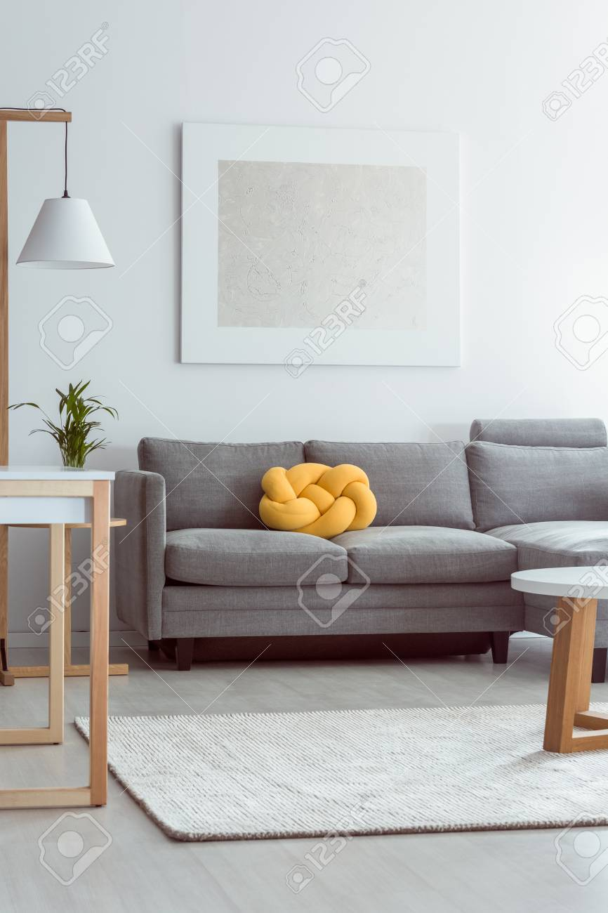 Yellow Knot Pillow On Grey Sofa In Cozy Living Room With White ...