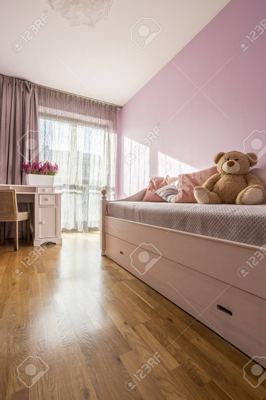 Lilac girly bedroom with elegant white furniture and teddy bear