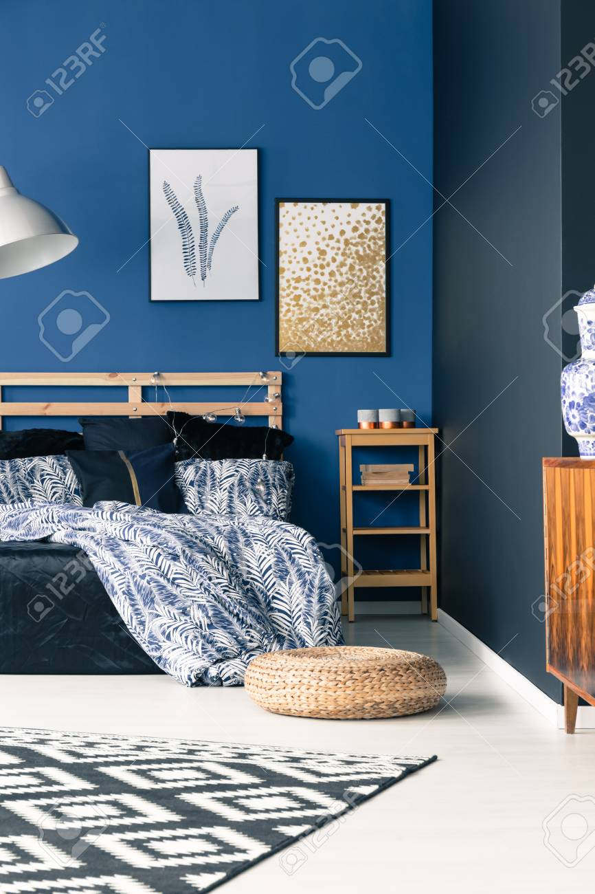 Image of: Sophisticated Bedroom With Elegant Blue Walls Carpet Pouf And Stock Photo Picture And Royalty Free Image Image 84817107