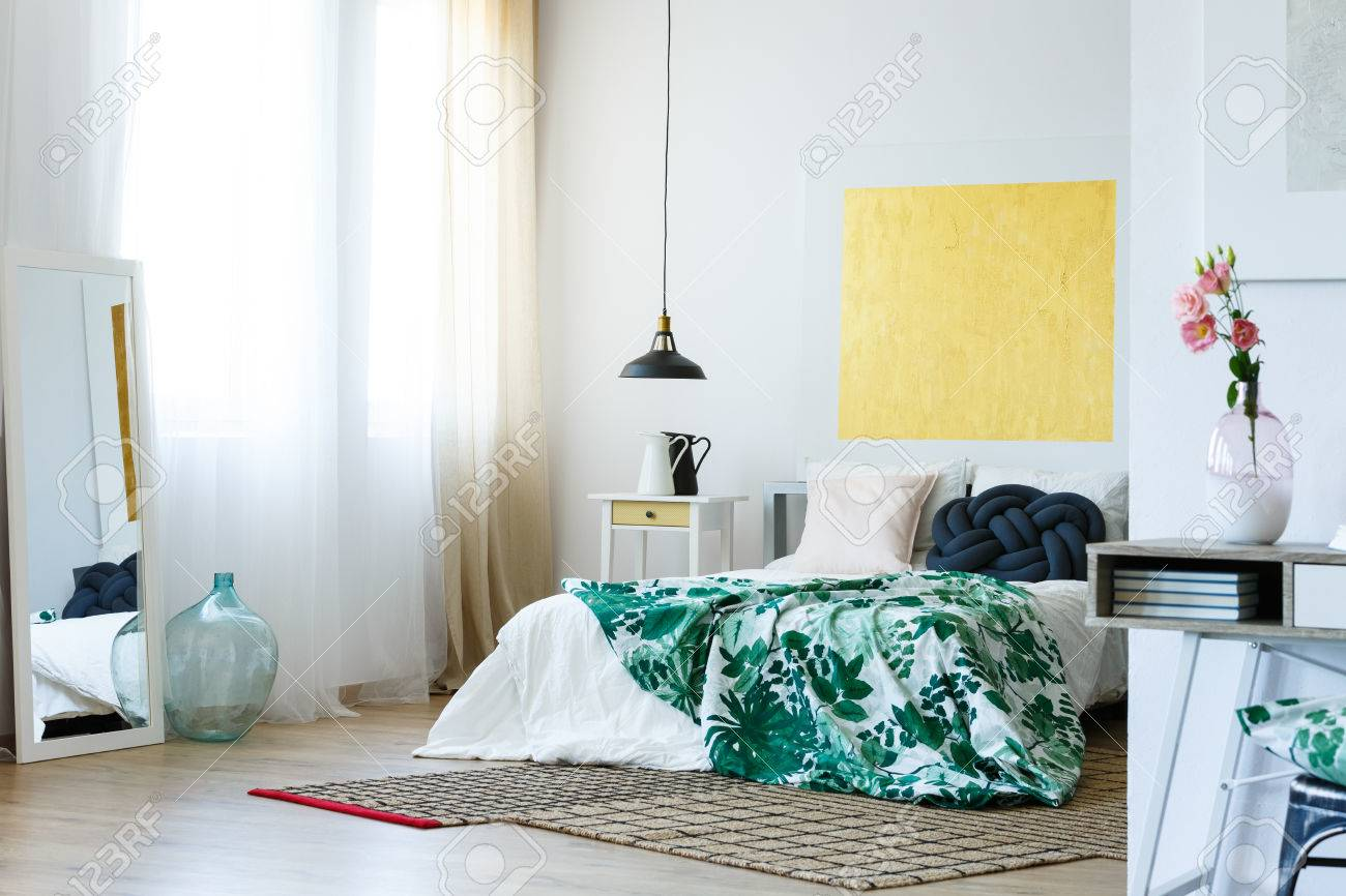Green, blue and yellow color scheme in modern master bedroom