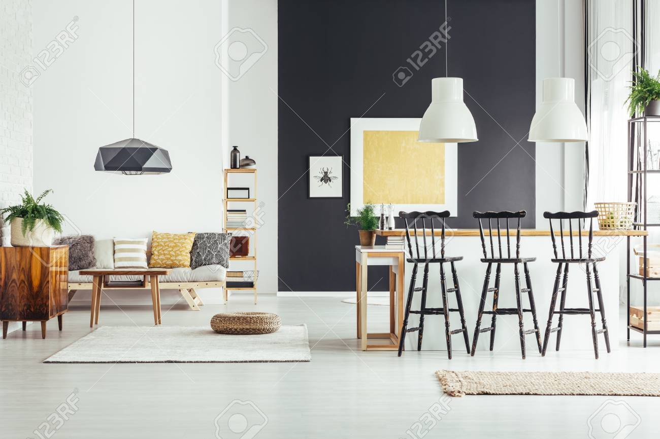 Black Bar Stools At Countertop Of Kitchen Island In Spacious Stock Photo Picture And Royalty Free Image Image 85057002