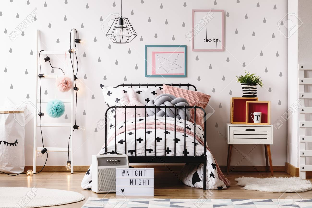 cozy kids furniture. Cute Pillows On Bed Against White Wallpaper With Grey Teardrops In Cozy Kids Room Colorful Furniture
