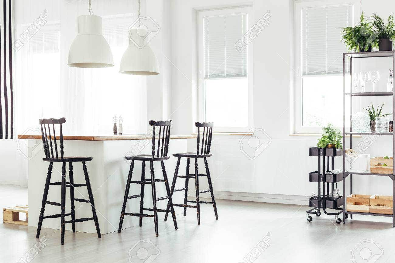 White Lamps Above Kitchen Island Under A Window With Black Bar ...