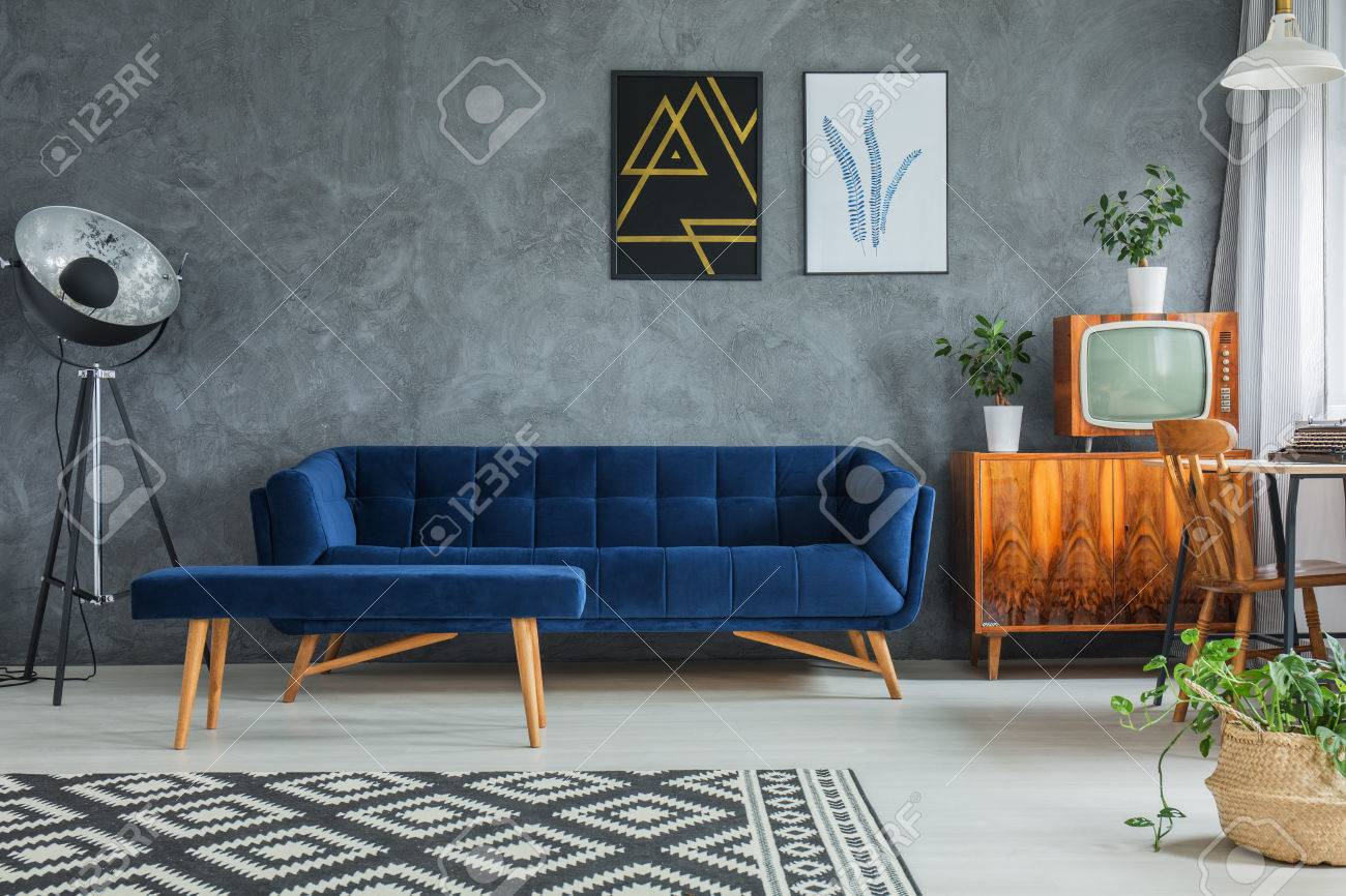 Tv Kast Wit Retro.Dark Blue Comfy Couch With Matching Footrest And Wooden Cupboard